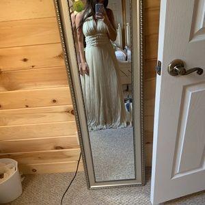 Carmen Marc Valvo long gold Roman gown